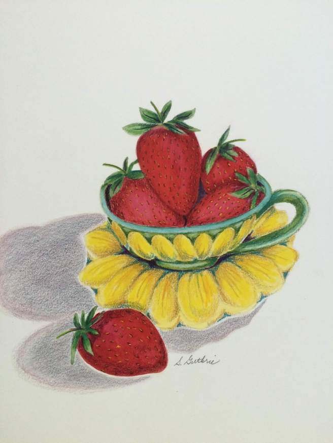 strawberries in a teacup